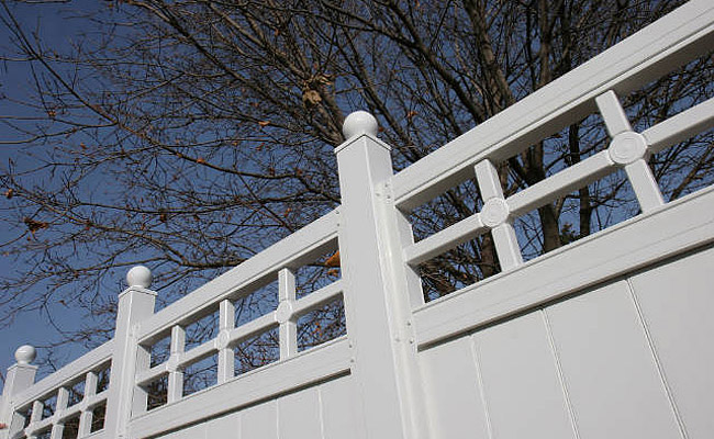 vinyl fence and gates beside home